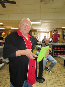 """Staff photo by Cathy Spaulding """"Kingpin Eddie"""" White polishes his bowling ball before rolling it down the lane. He said he bowled a 164 in that game."""