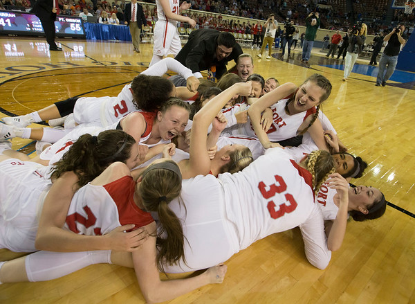 Phoenix special photo by Von Castor<br /> The Fort Gibson Lady Tigers dog pile at center court after defeating Harrah 55-41 in the Class 4A girls championship game on Saturday in Oklahoma City. The title is the fourth for the girls team and the first since 2014.