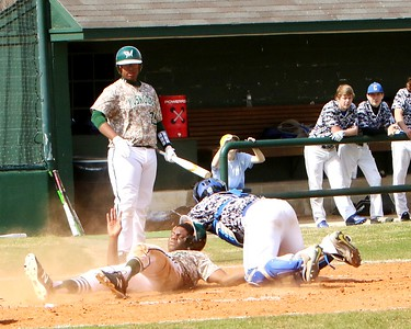Phoenix special photo by John Hasler Muskogee's Caleb Webb scores under the tag of Checotah's Dylan Mills during Saturday's game at Roughers Park. The Roughers won 15-7.
