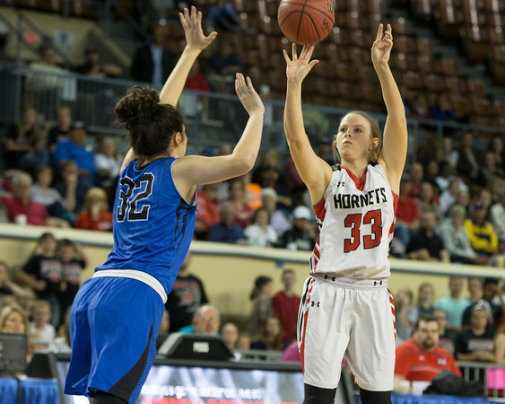 Phoenix special photo by Von Castor<br /> Hilldale's Kenzie Mize hits a 3-pointer over Harrah's Grace Brzozowski in the Class 4A semifinals at State Fair arena Friday night in Oklahoma City.