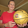 Staff photo by Cathy Spaulding<br /> Glenda McClain shows an autographed basketball she received from the Basketball Hall of Fame. As a player with the All American Redheads, McClain is in the Hall's Class of 2012.