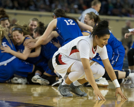 Phoenix special photo by Von Castor<br /> Fort Gibson's Alexis Wright fights back the emotion at the end of the Lady Tigers' 54-47 Class 4A championship defeat Saturday afternoon against Harrah.