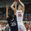 Phoenix special photo by Von Castor<br /> Fort Gibson's Kyle Dortch shoots over Kingfisher's Marco Charqueno during Saturday's Class 4A boys championship game at Jim Norick Arena in Oklahoma City. The Tigers lost 45-33.