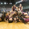 Phoenix special photo by Von Castor<br /> The Sequoyah Lady Indians celebrate in a 'dog pile' moments after winning the Class 3A girls state championship, 67-40, over Comanche Saturday at Jim Norick Arena in Oklahoma City. It was Sequoyah's second championship in the last three seasons.