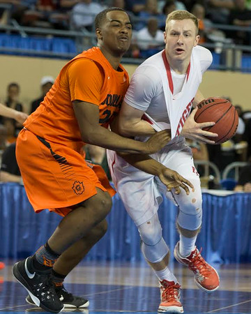 Special photo by Von Castor<br /> Fort Gibson's Kyle Dortch drives in the lane as Douglass' Andrew Williams defends Saturday in the Class 4A championship game at State Fair Arena.