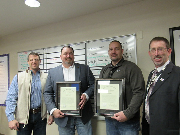Staff photo by Kenton Brooks<br /> Two men who work at the Jack C. Montgomery VA Medical Center were commended Monday for their work with suicide prevention. The men received commendations from Medical Center Director Mark Morgan. District 2 Rep. Markwayne Mullin attended the ceremony. From left: Mullin, William Barnes, Jason Self and Morgan.