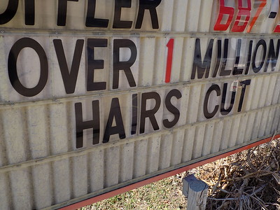 """Staff photo by Mike Elswick Barber shop owner J.W. Langton said the sign out front of this West Okmulgee Avenue shop has to be read carefully. He gets a laugh when customers come in and question whether he has really completed more than 1 million """"haircuts."""" Langton said with the average body having more than 20,000 hair follicles, he feels the claim he has cut more than 1 million """"hairs"""" over his 56-year career is not bragging, but fact."""