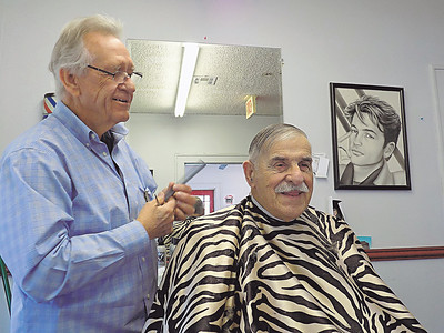 Staff photo by Mike Elswick Longtime Muskogee barber J.W. Langton works on trimming the hair on Bill Kilpatrick's head recently. Kilpatrick said Langton has been cutting his hair for decades. He said Langton always has stories to tell and is entertaining.