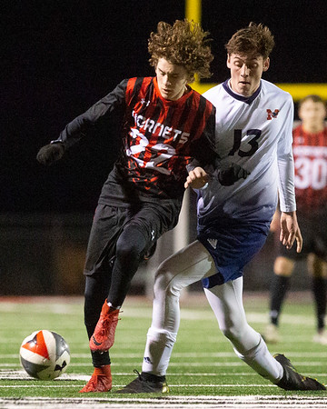 VON CASTOR/Phoenix Special Photo<br /> Hilldale's Corbet Weaver battles a Metro Christian defender for possession Tuesday night at Hornet Field.