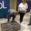 Staff photo by Cathy Spaulding<br /> Darla Paige Ryan, left, pushes a box containing memorabilia from Central High School Class of 1967 as Frances Haynes, center, and Lee Gordon watch. Ryan, Haynes and Gordon were members of the Class of 1967.