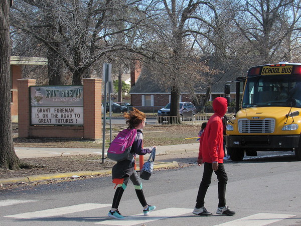 CATHY SPAULDING/Muskogee Phoenix<br /> Students use a crosswalk in front of Grant Foreman Elementary on Wednesday. Starting next school year, the building will house Muskogee Public Schools sixth-grade classes.