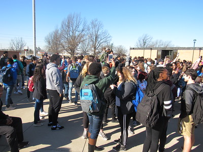 Staff photo by Cathy Spaulding Muskogee High School students take pictures while joining in a nationwide school walkout protesting gun violence. Students walked out for 17 minutes Wednesday morning.