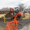 CATHY SPAULDING/Muskogee Phoenix<br /> Oklahoma Natural Gas excavators dig around gas lines Tuesday at several Dayton Street residences. Oklahoma Natural Gas Communications Manager Cherokee Ballard said water had been found in the lines.