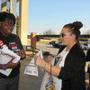 Staff photo by Cathy Spaulding<br /> Ben Franklin Science Academy teacher Sharica Cole, left, gives an Oklahoma Education Association information sheet to Ivy Skinner before a Muskogee Education Association town hall meeting, held Thursday at Muskogee High School.