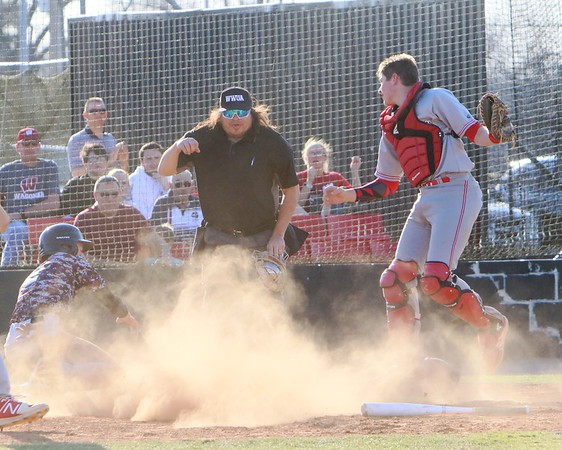 Phoenix special photo by John Hasler. Fort Gibson catcher Carson Ladd gets the out call at home on Wagoner's Nathan Timmons in Friday's game at Wagoner.