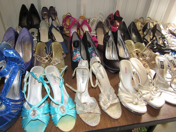 Staff photo by Cathy Spaulding<br /> They're not glass slippers, but Muskogee Salvation Army offers a variety of lovely footwear through its Bibidi Babidi Prom program. High school girls can find free promwear through the program.