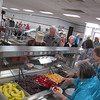 Staff photo by Cathy Spaulding<br /> Fort Gibson residents line up for the annual Golden Agers' Breakfast, held last week at the Fort Gibson School cafeteria, the Tiger Den. The Fort Gibson Chamber of Commerce picked up the breakfast this year.