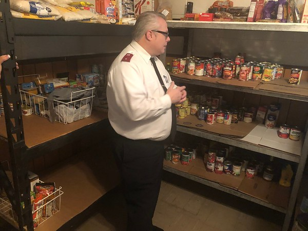 """CHESLEY OXENDINE/Muskogee Phoenix<br /> Lt. Rev. Charles Smith of the Salvation Army discusses the items missing from the Army's food pantry shelves following a rough month. """"Our shelves are running quite low on nonperishable food items, such as potted meats, peanut butter, beans, Vienna sausages. We are also running low on canned fruit, bagged or box rice, and pasta items,"""" Smith said. The pantry will also need more food as it plans to move from its appointment-based assistance to walk-in assistance in the near future, Smith said."""