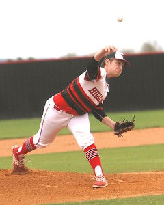 Phoenix special photo by John Hasler Hilldale's Logan Goss delivers a pitch in the Hornets' game at home against Roland. Goss struck out batters as Hilldale beat the Rangers 7-4.