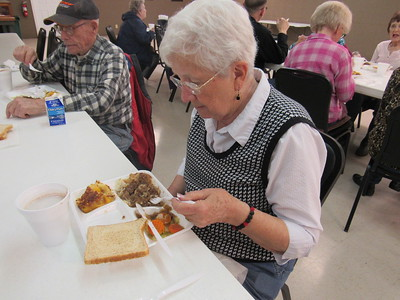 Staff photo by Cathy Spaulding Ann Miller's lunch at the Fort Gibson nutrition site features beef tips, vegetables and cobbler. The site is located at the Frank Gladd American Legion Post 20.
