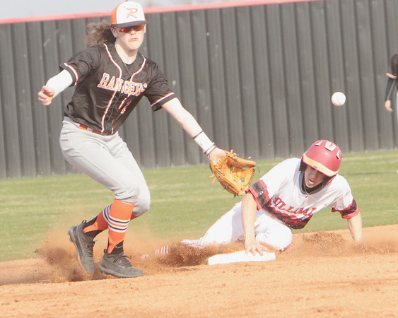 JOHN HASLER/Phoenix Special Photo<br /> Hilldale's Colby Thompson beats errant throw to Roland shortstop Paxton Pitts in Tuesday's game.