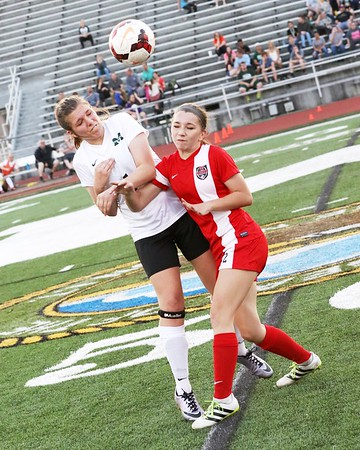 Phoenix special photo by John Hasler<br /> Fort Gibson's Madi Cook, right, collides during a header with Muskogee's Montana Cole during Monday's game on Creek Nation Field at Indian Bowl.