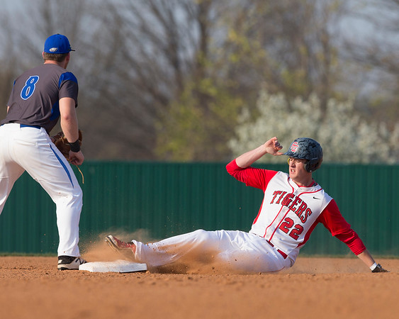 Phoenix special photo by Von Castor<br /> Fort Gibson's Caden Berry slides into second base for a double on Monday against Claremore Sequoyah at Carr-O'Dell Tiger Park.