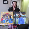 CATHY SPAULDING/Muskogee Phoenix<br /> Bacone College Vice President of Development Mindi R. Kee holds two works by Johnnie Diacon to be sold by lottery Saturday night. Kee said the works show two sides of the famed Bacone<br /> style of Native art.