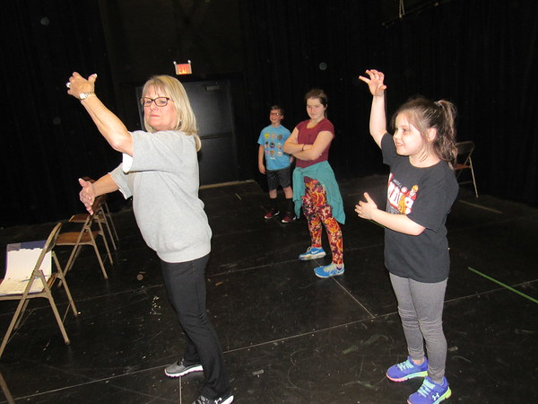 """CATHY SPAULDING/Muskogee Phoenix<br /> Dance instructor Francie Martin, left, shows Allie Goss how to play an invisible bass guitar during dance rehearsals for """"Beat Bugs."""" Muskogee Little Theatre will present the Spring Break Camp production Friday, Saturday and Sunday."""