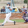Phoenix special photo by John Hasler<br /> Oktaha's Korey Walker drives a two-run single up the middle in the bottom of the sixth as Vian's Graylen Fletcher watches as the Class 2A No. 1 Tigers beat the 3A No. 5 Wolverines 10-5 on Tuesday in Oktaha.