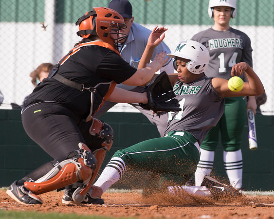Special photo by Von Castor<br /> Muskogee's Phynix Coleman slides in safely to home plate ahead of the throw to Booker T Washington's Jessica Suggs during Tuesday's game.