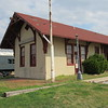 """Staff photo by Cathy Spaulding<br /> Wagoner's Katy Depot stands battered and empty at it's """"new"""" location three miles north of the city. The Wagoner Switch District is working to move the depot back to town."""