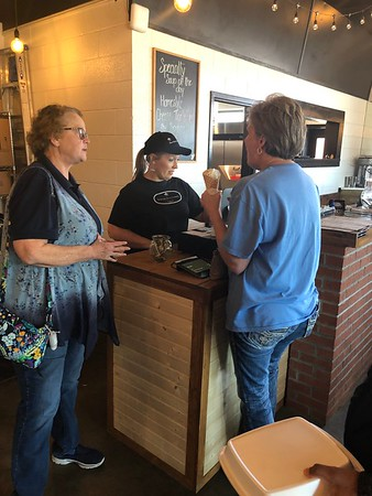 CHESLEY OXENDINE/Muskogee Phoenix<br /> Freedom House Program Manager Kathy Love joins Streetside Deli, Creamery, and Artisan Coffee Cafe employee Melissa in ringing up a customer Friday afternoon.