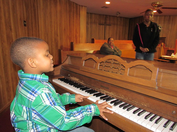 Staff photo by Cathy Spaulding<br /> Prinz-Rick Morgan, 5, can play bass notes and chords on the piano. He has been singing at his church since he was 2.