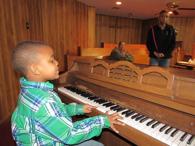 Staff photo by Cathy Spaulding Prinz-Rick Morgan, 5, can play bass notes and chords on the piano. He has been singing at his church since he was 2.