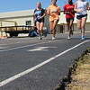 Staff photo by Cathy Spaulding<br /> Warner High School runners, from left, Madison Ramming, Bailey Epps, Jaelisa Tolbert and Callie Glisson run on the school's asphalt track. School officials hope to resurface the track if a $340,000 bond issue passes.
