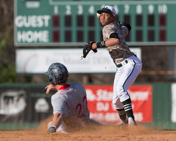 Phoenix special photo by Von Castor<br /> Muskogee's Christian Webb attempts a throw to first as Fort Gibson's Kadin Berry slides. Webb turned a double play, but Fort Gibson went on to win 8-4.