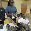CATHY SPAULDING/Muskogee Phoenix<br /> Asharia Jones of St. Paul United Methodist Church puts donated shoes in a box. Church youth will take shoes on a mission trip this summer.