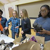 CATHY SPAULDING/Muskogee Phoenix<br /> St. Paul United Methodist Church youth, from left, Aspen Jones, Melysa Cobb, Kelie Cobb, Asharia Jones sort shoes they'll take on a mission trip to Nashville. The group Soles4Souls distributes the shoes to developing countries.