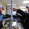 KENTON BROOKS/Muskogee Phoenix<br /> Jim Hancock, right, picks up his barbecue that was served by Jim Erb during Saturday's Okay Centennial Celebration at the Okay Senior Citizen Center. Hancock is a retired Okay teacher and coach and was among the crowd that filled the Citizen Center. The barbecue was sold to raise money for the Youth Center that will be built in front of the Okay Christian Fellowship Church.