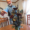 CATHY SPAULDING/Muskogee Phoenix<br /> Gerald Brostek created the butterflies, flowers and other items on this metal bouquet. He said he crafts items for himself nowadays.