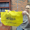 CATHY SPAULDING/Muskogee Phoenix<br /> Fort Gibson Town Clerk Shelley Steffes holds a free Great American Cleanup bag that residents can pick up at Town Hall in preparation for Free Dump Day on Saturday.