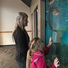 Special photo by Travis Sloat<br /> Payton Crum, 7, along with her mother Paige Mannon watch the fish<br /> swim in the tank at Arrowhead Mall. Payton was born with Optical Nerve<br /> Hypoplasia, and her family is seeking help to purchase eSight glasses<br /> which would give her 20/20 vision.