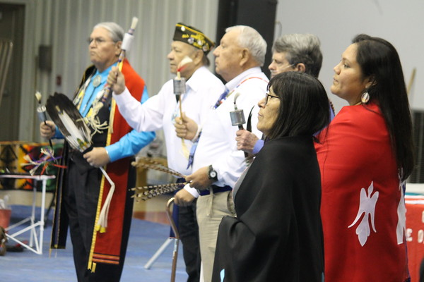 Special photo by Chesley Oxendine<br /> Native American veterans stand for the Gourd Dance during Saturday's powwow at Bacone College.