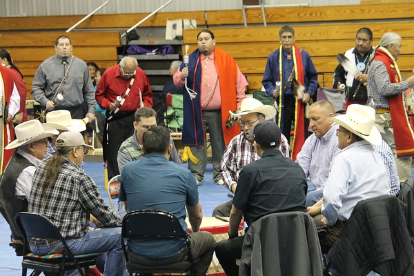 Special photo by Chesley Oxendine<br /> Veterans stand for the Gourd Dance while drummers lead the ceremony at Bacone's 2018 Spring Contest Powwow.