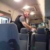 KENTON BROOKS/Muskogee Phoenix<br /> Muskogee County Transit Operations Manager Jon Moore sprays the seats inside one of the transit's 34 buses that carry passengers in the county. Executive Director Dena Wilson said the buses are cleaned every day.