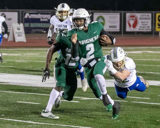 SHANE KEETER/Special to the Phoenix<br /> Muskogee's Ty Williams, playing quarterback, tries to shake loose of a Choctaw defender last season. Williams is a growing commodity in the college recruiting world. He has 12 major college offers so far.