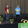 "Special photo by Travis Sloat<br /> Logan Rhyne, right, smiles as he hears his final word given at the Eastern Oklahoma State Spelling Bee at the Muskogee Civic Center. Rhyne correctly spelled ""wedel"" to win the bee in the sixth round. Kyle Newell, left, won second place."