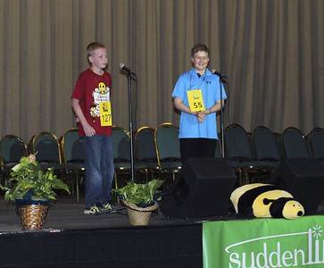 "Special photo by Travis Sloat Logan Rhyne, right, smiles as he hears his final word given at the Eastern Oklahoma State Spelling Bee at the Muskogee Civic Center. Rhyne correctly spelled ""wedel"" to win the bee in the sixth round. Kyle Newell, left, won second place."