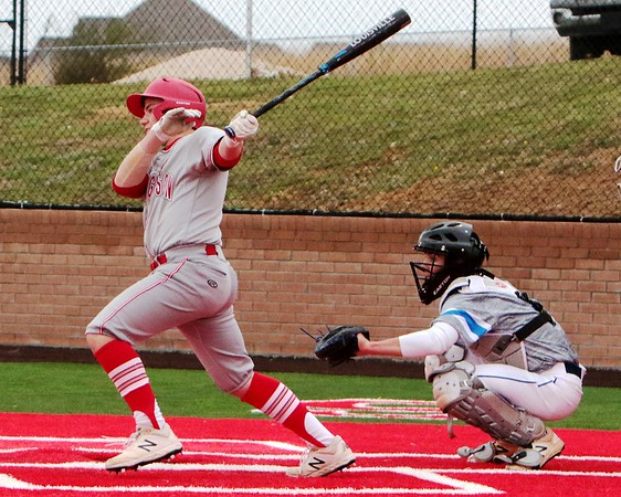 JOHN HASLER/Phoenix Special Photo<br /> Fort Gibson's Kennedy Cook smacks a two-run single in the bottom of the second for Fort Gibson's final runs in a 3-0 win over Claremore Sequoyah on Monday. Sequoyah's catcher is Trey Burks.